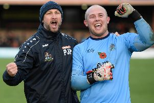 Altrincham boss Phil Parkinson celebrates with keeper Anthony Thompson following the Robins' FA Cup victory at York  Picture: George Wood/Getty Images