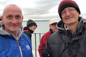 Proud dad's Gareth Wood, 44, and Darren Day, 54, watching HMS Prince of Wales arrive in Portsmouth.