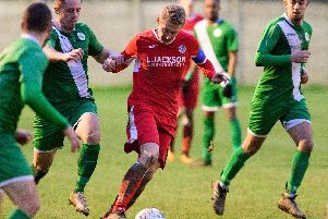 Ash Howes (red) was praised by Horndean boss Michael Birmingham following the 4-1 win over Wessex leaders Alresford