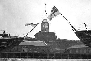The original Semaphore Tower, destroyed in 1913, and the sterns of two royal yachts. Picture: Mick Cooper postcard collection.