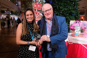 Rachel Lowe receiving the award from Alan Simpson, chairman of the Toy Retailers Association.