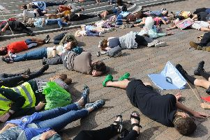 Extinction Rebellion protesters staging a die-in in Guildhall Square earlier this year. Picture: Duncan Shepherd