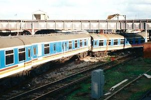 The footbridge at Fratton station was nearly brought down when this train derailed beneath it. Picture: Andrew Cooper.