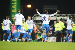 Pompey celebrate Andre Green's late winner against Norwich in the FA Cup third round. Picture: Joe Pepler