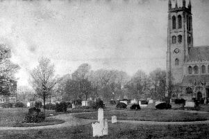 St Marys churchyard with the old vicarage behind the trees immediately to the left of the bell tower.