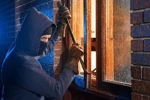 Criminals are breaking into people's homes and stealing cars. Photo posed by a model.