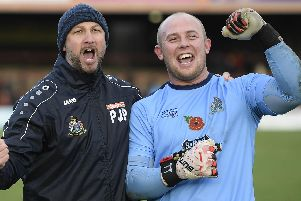 Keeper Anthony Thompson celebrates with Altrincham boss Phil Parkinson after their FA Cup first-round win over York. Picture: George Wood/Getty Images