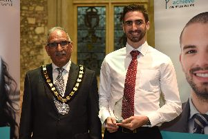Neil Redman with Chairman of Hampshire County Council, Cllr Charles Choudhary accepting his Chairman's Award.