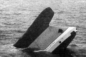 The bow of the Russian factory ship, Gorizont, protrudes from the sea off the Isle of Wight.