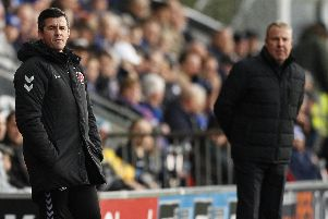 Fleetwood manager Joey Barton, left, and  Kenny Jackett   Picture: Daniel Chesterton