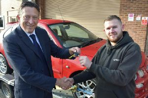 Mark Ryder Strategic Director for Communities Warwickshire County Council'hands over the keys to a MG ZR automatic to Josh Saul of Warwickshire College. Photo supplied