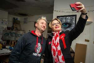 3/12/19''Eddie Izzard is visiting Portsmouth to support MP Stephen Morgan for the election.''Pictured: Eddie Izzard taking a selfie with 'My Dog Sighs' Artist at his studio above Wedgewood Rooms, Portsmouth.'''Picture: Habibur Rahman
