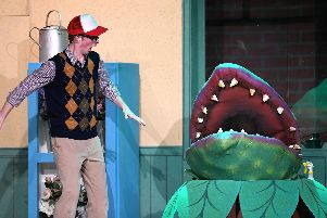 Matt Hammond as Seymour with Audrey II.