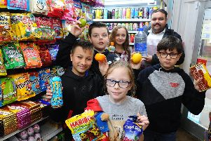 Mohamed Sahabudeen, one of the owners of Sweetland Convenience Store, with pupils Charlie Turner, 11, and Jessica Hallett, 10, (back) and Leo Churchill, 10, Anna-May Philpott,10, and Nathan Nicholson, 10.''Picture: Sarah Standing