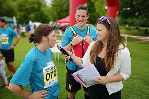 Annelies James chatting to marathon runners at an event she hosted.