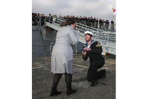 Leading Engineering Technician Jordan Andrew proposes to his girlfriend Charlotte Winsor.'Picture: LPhot Joe Cater