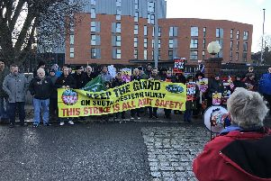 Protesters outside Fratton Station. Picture: David George