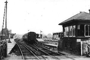 A Waterloo-bound train passing through temporary platforms at the west end of Havant station, 1937.