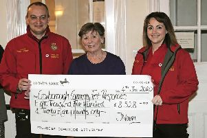 Crowborough Community First Responders accepting a cheque at Crowborough Beacon Golf Club's AGM