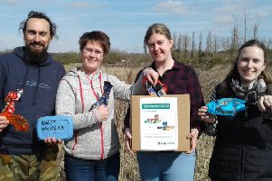 Warwickshire Wildlife Trust staff Pete Thorne, Louise Barrack, Philippa Truman and Debbie Wright with biscuit wrappers. Photos by Paula Irish (WWT) 2018.