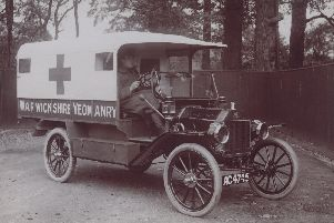 Sergeant Geoffrey Gibbs driving a Warwickshire Yeomary ambulance during the war