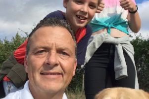 Paul with son Callum, daughter Annie, and their family dog, Dudley.