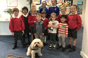 Woody with his trophy along with children from Dunchurch Infant School and Nursery and Dunchurch Boughton Junior School.