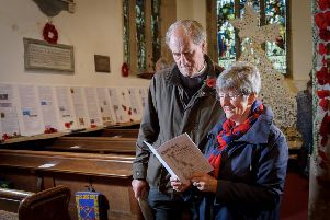 The Reverend Paul Wilkinson and Judith Edwards at the exhibition in St Botolph's Church, Newbold  which included her biographies of all 52 names on the war memorial which stands in  the churchyard
