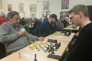Rugby Chess Club's Jamie Kearney ( pictured on the right) playing Grand Master Mark Hebden at the Coventry & District Centenary Rapidplay at the Massey Ferguson Club in Coventry