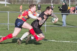 Mike Howes dives over for a try