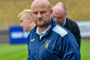 Rugby Town manager Carl Adams praised his side's performance in their top-of-the-table win at Deeping Rangers last week, which lifts them back into second place