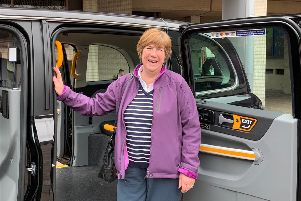 Lynne Stagg inspects one of the taxis. Picture: Suzy Horton