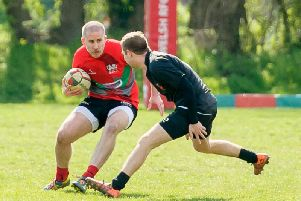 Angus Wilson with the ball for Rugby Welsh