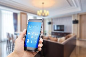 Many smart devices are connected through your phone, allowing you to have full access of your technology even when you're out and about (Photo: Shutterstock)