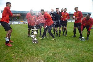 Champagne celebrations for Community Relations after their Hospital Cup win against Courthouse