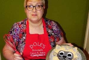 Ginny Dole's colourful kitty cake will be raffled online to raise funds for BARKS.