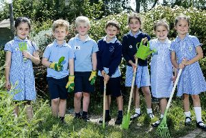 East Preston Infants School pupils Hollie, Arthur,Charlie,Thomas,Serena, Tallulah and Lilly with tools donated by CALA Homes