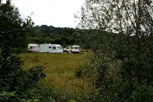 An encampment of caravans has been spotted off Edgar Mobbs Way.