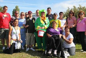 Pictured, (from left, back), are sponsored walkers Adam Smith, Barry Ashton, Sheila Ashton, Tony Boswell, Shaun Maltby, Matthew Bulton, Justin Maltby, Kevin Freibergs, Long Phong, Sheila Daffdern and Jane Hooper; and (front) Sara Johnson, Anita Savage and Tina Mellors.