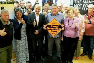 Rana Das-Gupta, pictured centre left next to Cllr Neil Sandison who is holding the Lib Dem diamond.