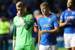 Craig MacGillivray, left, and Ross McCrorie dejected after the draw with Burton. Picture: Joe Pepler
