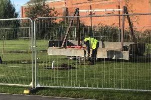 A workmen helps to dismantle equipment at the playground.