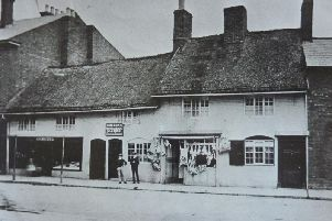 Shops under thatch in Rugbys Church Street , taken in 1873