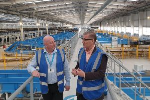 Rugby MP Mark Pawsey (right) was shown around Hermes 31 million Parcel Hub by Craig Ryder, hub general manager (left).