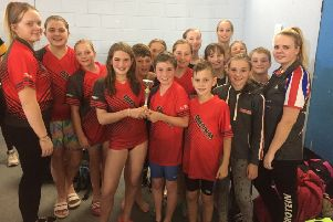 The Deepings Swimming Club team with their third-place trophy in the Junior Fenland League B Final
