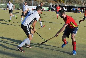 Action from City of Peterborough (red) v Southgate. Photo: David Lowndes.