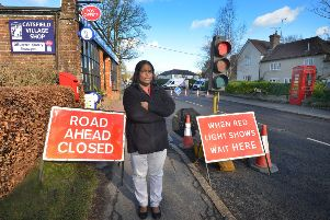 Priya Kumanan from Catsfield Village Shop is annoyed at the ongoing roadworks outside her shop. SUS-190128-134641001
