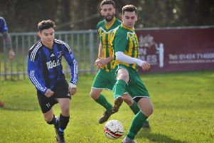 Hollington United midfielder Ricky Martin tussles for possession during the 7-0 win away to AFC Uckfield Town II. Picture by Justin Lycett