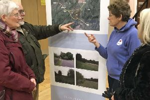 Residents discussing major development plans in Battle SUS-190218-112344001