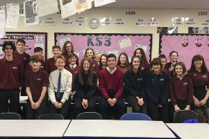 Huw Merriman with students at Robertsbridge Community College SUS-190225-100949001